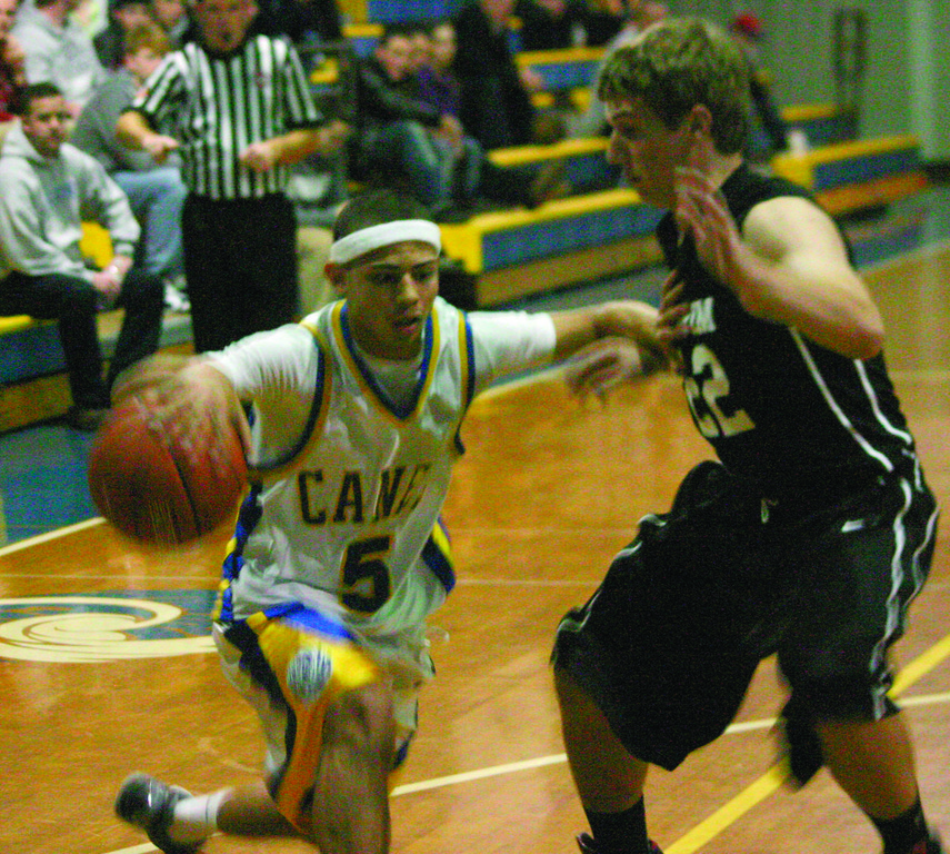 RIVALS: Carter Thomas heads to the basket on Pilgrim's Andrew Schoepher.