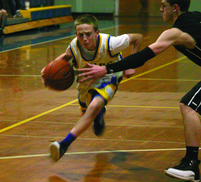 DOWN THE LANE: Vets guard Josh Muto gets a step on Pilgrim's Cole Furney in Tuesday's game. Vets played its best game of the year to pick up its first victory.