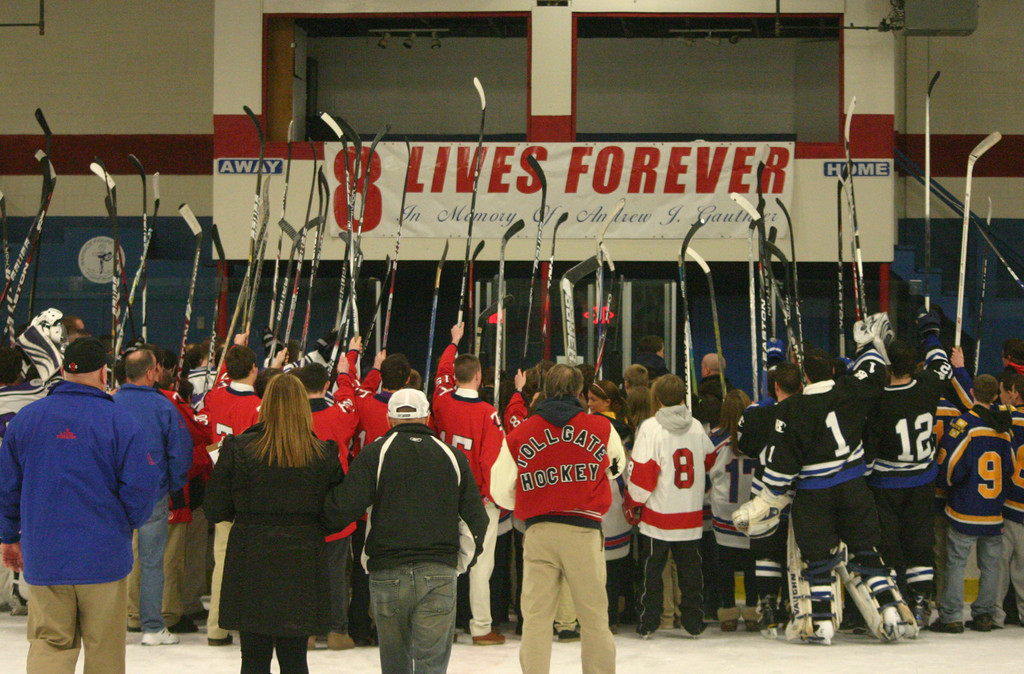 SALUTE: Teams raise their sticks in front of a sign honoring Andrew J. Gauthier at last year's hockey festival. The sixth annual event is scheduled for Jan. 20.
