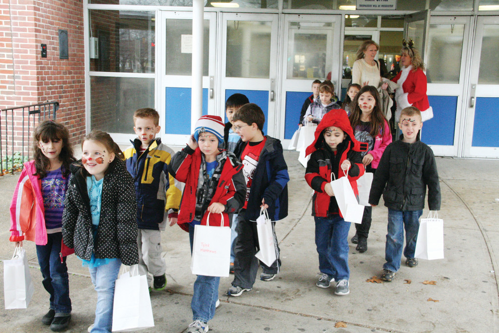 ON THE WAY BACK: Park School first graders leave Vets Monday after attending a party hosted by the Vets Leadership Academy.