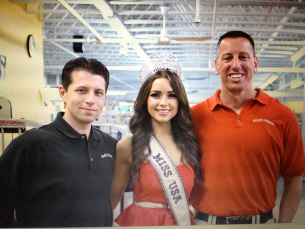 BACK TO THE GYM: After winning the Miss USA pageant, Olivia Culpo, who won the Miss Universe Pageant last week, visits with trainers Brian Rector and Scott Read.