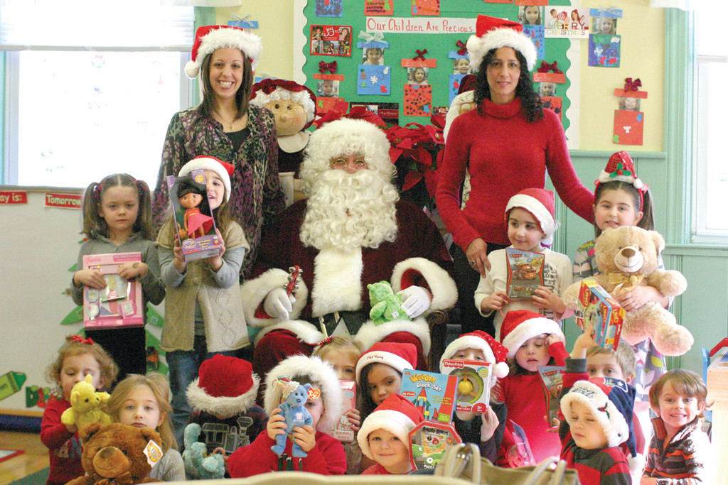 The entire class poses for a photo with Santa and their teachers on the Thursday before Christmas.