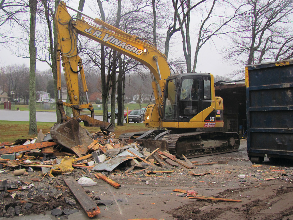 Several large pieces of demolition equipment filled Memorial Park as the one-time Parks and Recreation Office was torn down to make room for a new facility. J.R. Vinagro Corporation, a Johnston company, did the entire demolition job.