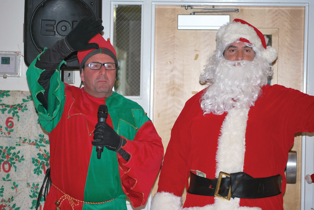 Santa and his elf make a surprise appearance at Forand.