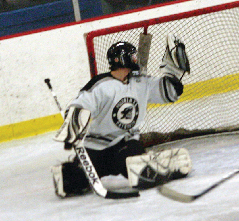 GLOVE SIDE: Pilgrim goaltender Devon Gamba makes a save during Friday's 9-3 win against Johnston/North Providence. Gamba and the Pats won both their games over the weekend to break an 0-4 start.