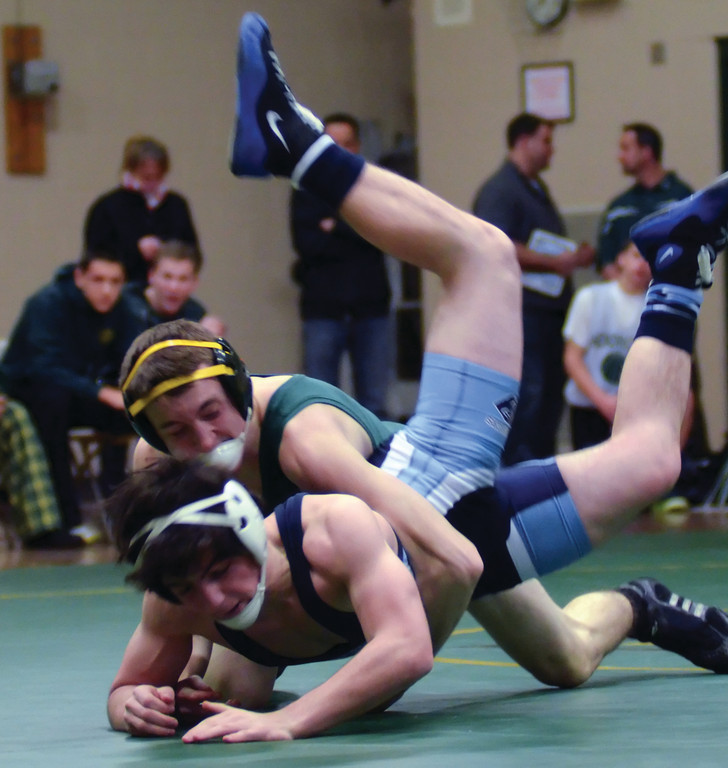 Nick DiMauro lunges to take down Mike Caparco.