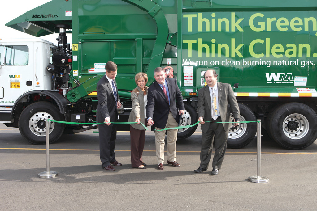 CLEANER AND GREENER: Cutting the ribbon at the Cranston CNG fueling facility are Tim Horan, Jurisdiction President - Rhode Island, National Grid; Marcia LoPresti, Economic Development Aide, City of Cranston; Chris DeSantis, Area Vice President, Waste Management; and Lawrence DiBoni, Director - Economic Development, City of Cranston.