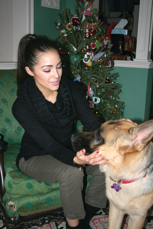 Culpo returns home to Cranston for the holidays, and relaxes with Louie, one of the family dogs.