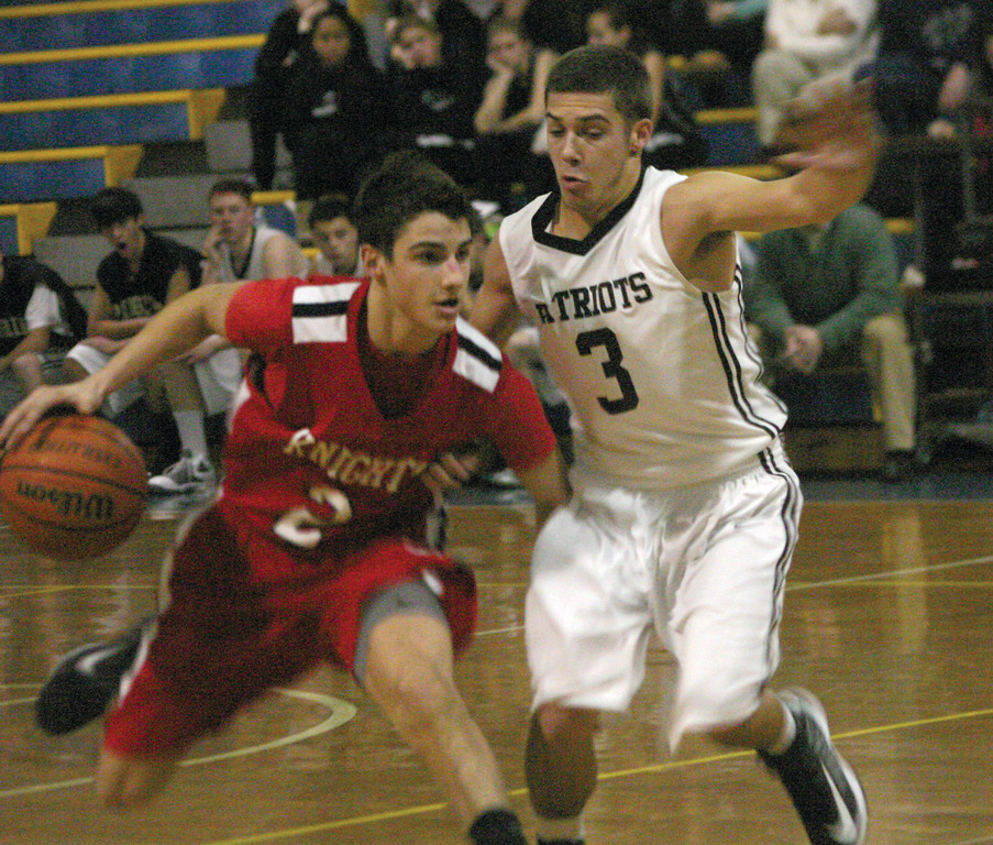 SIDE BY SIDE: Pilgrim's Seth Lawson tries to stay with PCD's Nick DeBlasio on Friday in the championship of the Warwick Beacon Holiday Classic. PCD used a 28-0 run to blow open a 10-point game on its way to a 75-43 victory and its third straight tournament title.