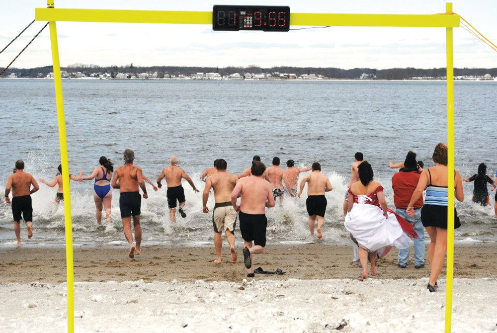 TAKING THE PLUNGE: A crowd of New Year�s Day �plungers� heads toward the water on Monday for the second annual Frozen Clam.