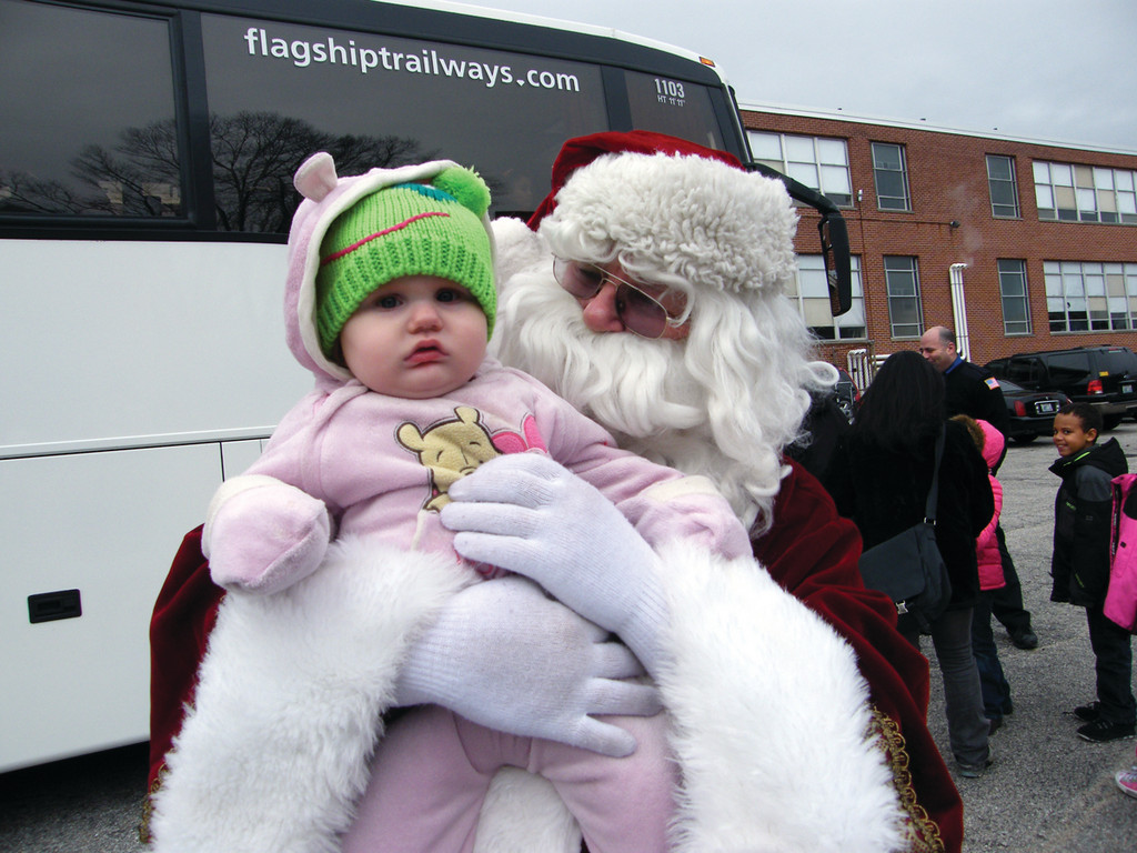 BUNDLED UP: Santa holds Debra Brouillard, 11 months, before handing her back to mom, Margaret, who stands just off camera.