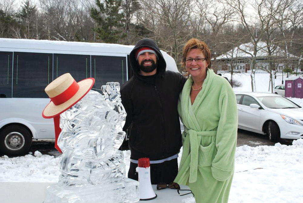 THE FROZEN CLAM: Ryan McGowan, owner of Laid-Back Fitness and creator of The Frozen Clam, poses for a photo with the Frozen Clam ice sculpture and Jo-Ann Schofield, senior vice president of the Rhode Island Mentoring Partnership.