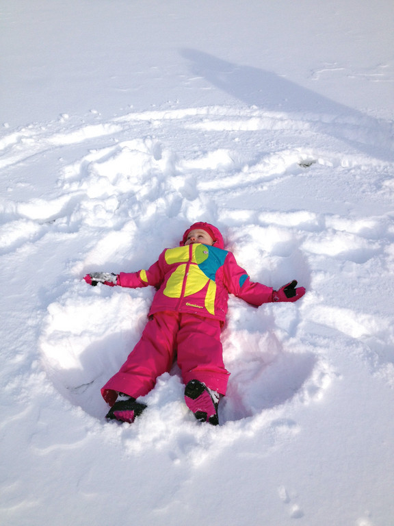 Ella Desrosiers makes a snow angel in the first major snowstorm of the season.