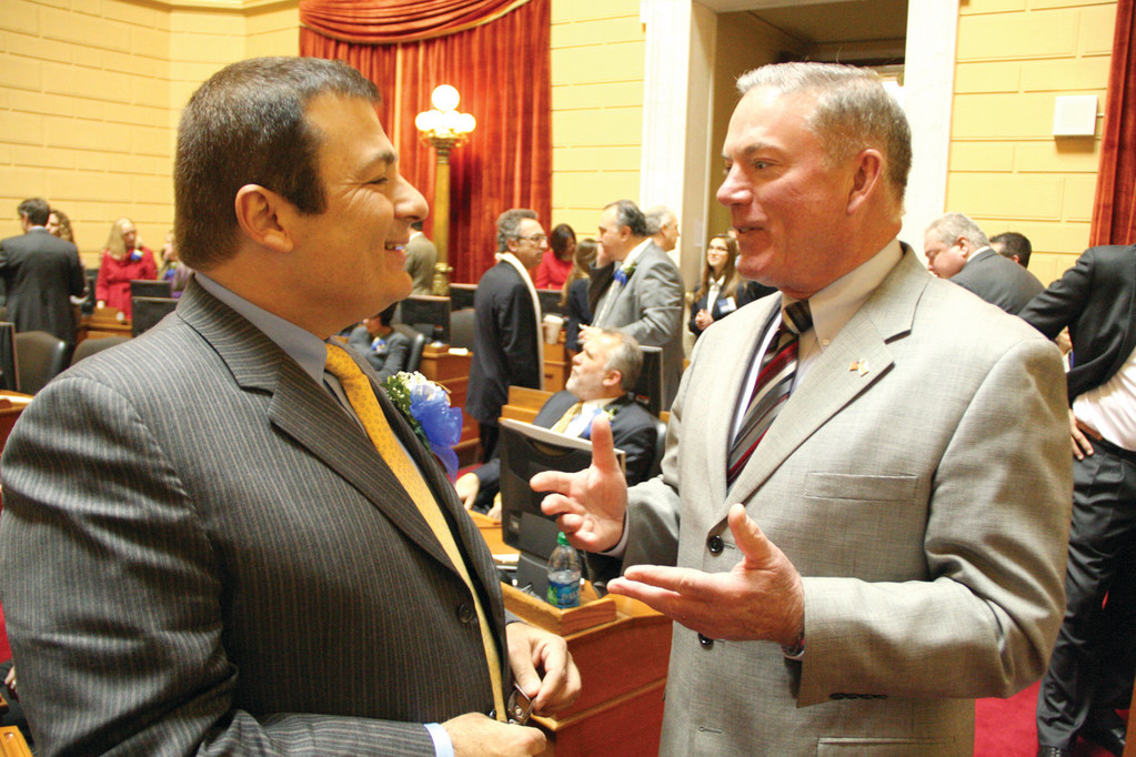 Warwick's newest House member, K. Joseph Shekarchi and Rep. Joseph McNamara chat at the start of the session Tuesday afternoon.