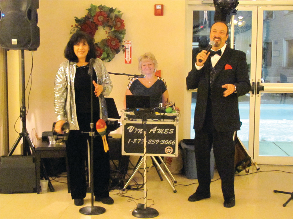 The Vini Ames Trio set the tone for the JSC�s second annual New Year�s Eve gala Monday evening. Pictured is vocalist Debbie Larson, Stephanie Ames on keyboard and singer Vini Ames.