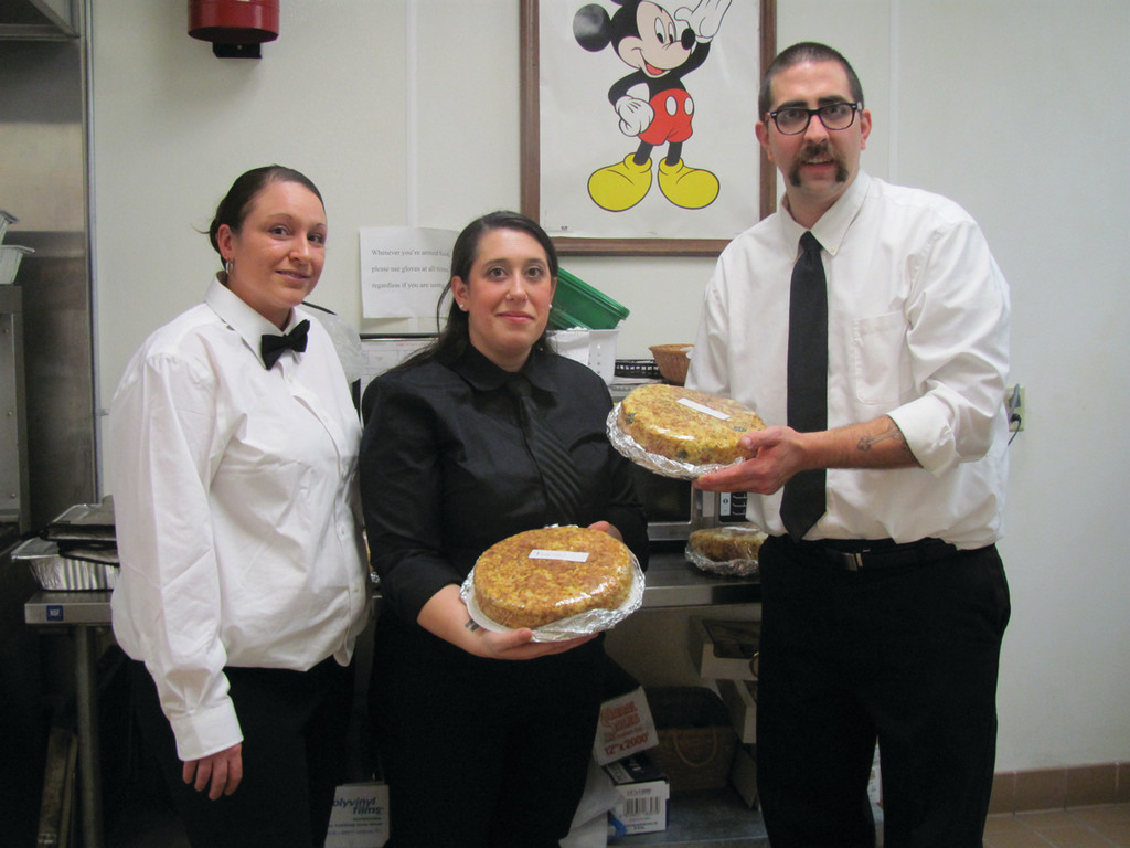 Among those people who volunteered as servers for the Johnston Senior Center�s gala New Year�s Eve party were, from left, Sheena Andrus, a staffer at Briarcliffe Manor, and Jacquelyn and Matt Conroy.
