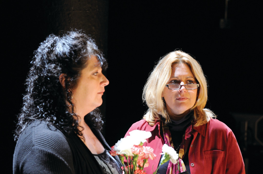 SURVIVORS: Jenn Krapf (left) and Kathy McCormick, two of the survivor-performers of �Behind Closed Doors,� during a scene. The play debuted in December at Trinity Reparatory Company