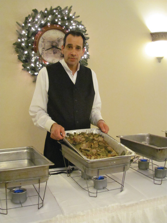 Nick Vaharakos dishes out sausage and peppers as part of the Italian buffet provided by Marchetti�s.