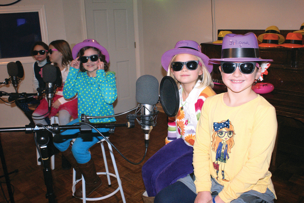 "A SPECIAL BIRTHDAY: Cristina Tortolano, age 8, sits in between her friends Simone Semerjian, Regan Kelly, Mallory Mongion and Juliana Spatano as they sing a song from the soundtrack from ""Men In Black."""