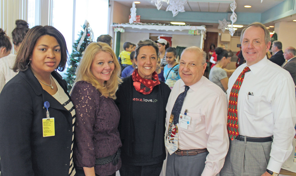 CARE DURING THE HOLIDAYS: Health Center employees Daphney Balan and Kelly O'Malley are pictured at the annual Christmas party with Sheri Masiello, Dr. Joseph Samartano and Kenneth H. Belcher, president and CEO of CharterCARE Health Partners.