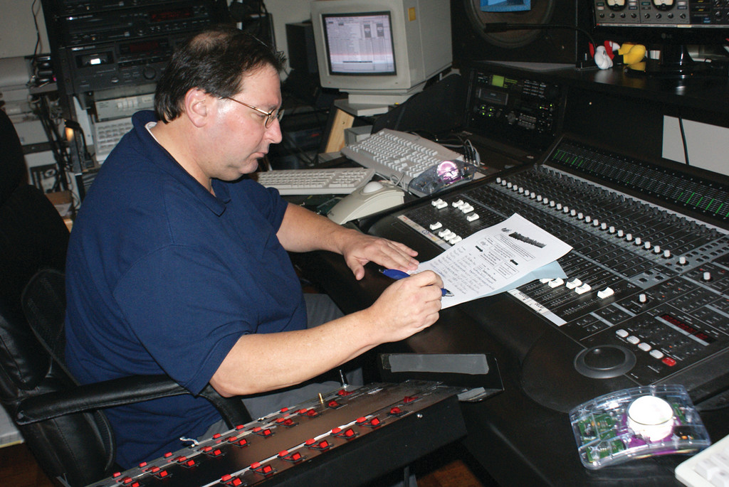 PAYING IT FORWARD: Anthony Marrapese of Cranston, owner of Reel to Real Recording Studio, helps record a CD for cancer survivor Cristina Tortolano. The two met through his work with Make A Wish.