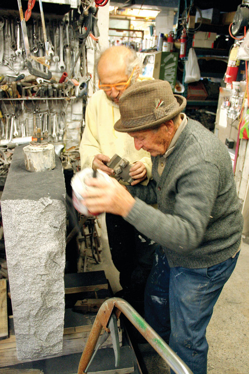 FATHER & SON: Anthony Sciolto and his son Anthony R. Sciolto work as a team at the Cranston monument company that bears their names. At 95, the senior Sciolto still drives a forklift, as he did for the installation of the Warwick memorial for the victims of the Station Nightclub fire, and works daily. He followed in the footsteps of his father, Vito, who came to this country from Italy, although his father died before he got to see his son's business.