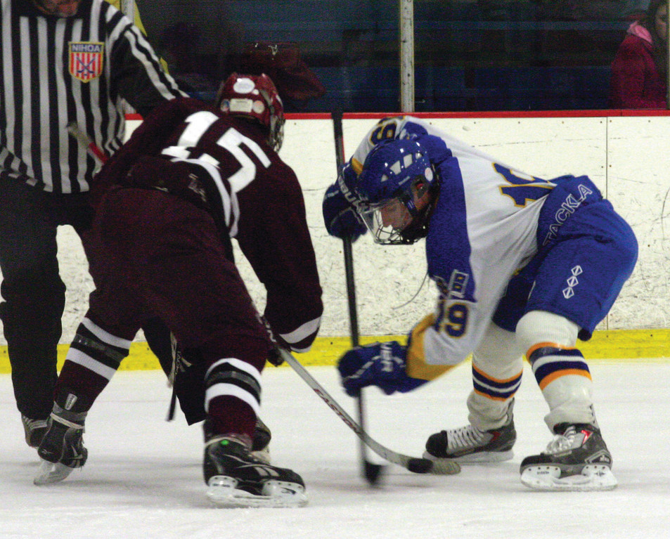 STEPPING UP: Andrew Morrissette battles in a face-off on Friday. Morrissette scored both goals in a 2-2 tie against Woonsocket.