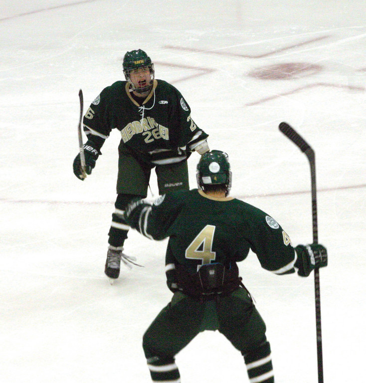 STILL GOT IT: Brandon Waterman, left, celebrates his third period goal with teammate Liam Watkinson on Saturday.