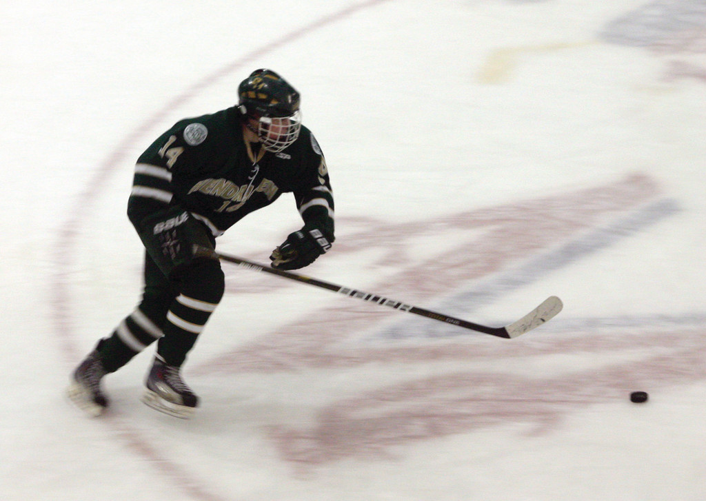 CENTER ICE: Hendricken's Joshua Olson speeds through the neutral zone during Saturday's game.