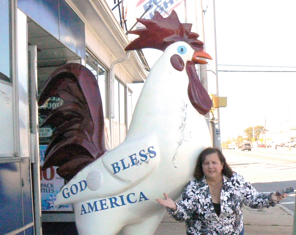 SHE'S NOT CHICKEN: Ward 3 Councilwoman Camille Vella-Wilkinson is drafting an ordinance that would allow residents to own chickens. Here, she is outside of Sollitto's Liquor Store in Providence.