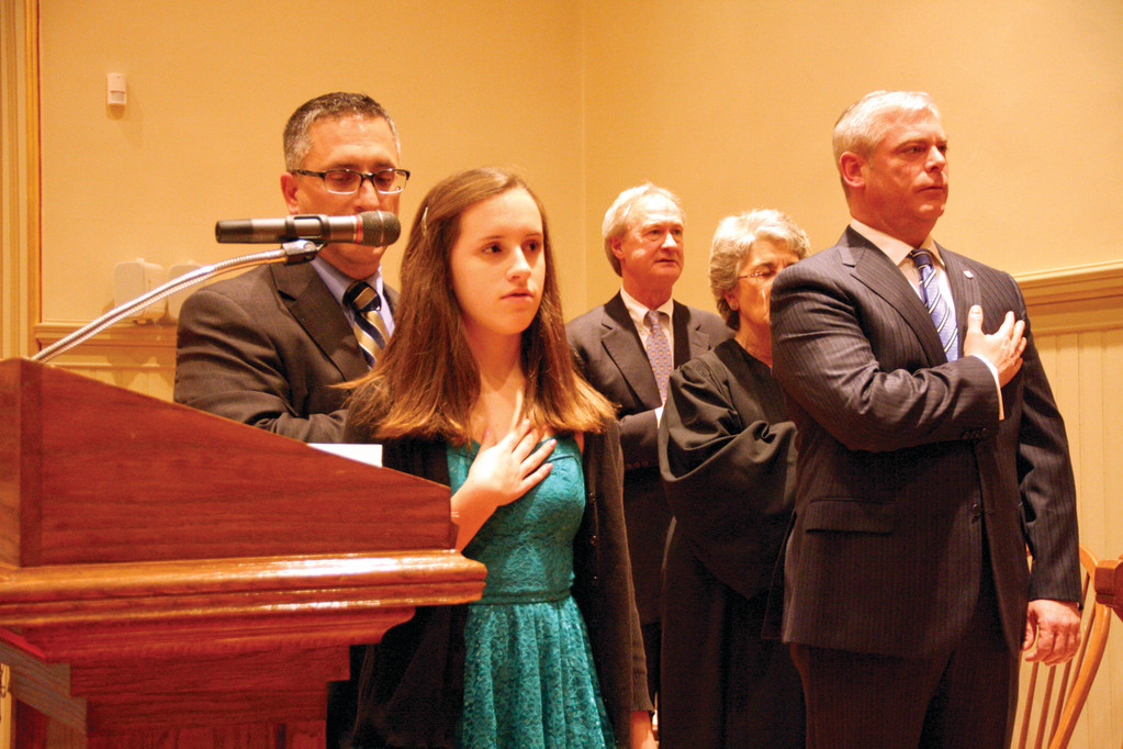 Ward 1 Councilman Steve Colantuono (left) served as Master of Ceremonies, while his daughter, Sophie, led the assembly in the Pledge of Allegiance. Governor Lincoln Chafee, Judge Haiganush Bedrosian and Avedisian look on.