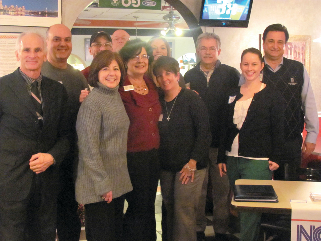 Terry Marquez Wildemann (center front) is joined by North Central Chamber of Commerce President Deborah Ramos and some of the people who attended Monday�s �Transform your Networking in 2013� Night.