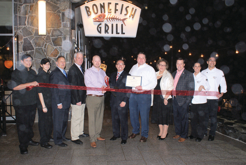 WELCOME BONEFISH GRILLE: Bonefish Grille officially unveiled their new restaurant, located at 2000 Chapel View Blvd. in Cranston with a ribbon cutting ceremony on Jan. 12 with Cranston Mayor Allan Fung and other local dignitaries. Following the ribbon cutting, a fundraiser benefiting The Groden Network took place as guests were invited to sample food specialties and cocktails with 100 percent of the proceeds from ticket sales benefiting The Groden Network. Pictured from left is Darien Kapture, Melany Oliveira, Rep. Peter Palumbo, Ward 2 Councilman Don Botts, Managing Partner Bryan Schosker, Mayor Allan Fung, Joint Venture Partner Michael Dearing, Groden Center CEO Helen Morcos, Groden Director of Government Affairs and Marketing Lee Beliveau and Bonefish Grille servers Elizabeth Leighton and Christopher LaColley.