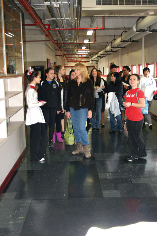 ASK ME: Erin Durigan leads a group of Future Falcons on a tour of Cranston West, answering questions along the way.