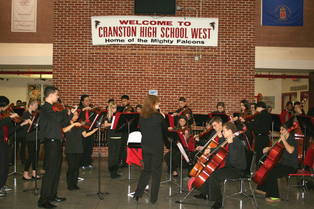 MUSICAL ENTERTAINMENT: The Cranston West orchestra plays in the school lobby, as light refreshments are served and school tours take place.