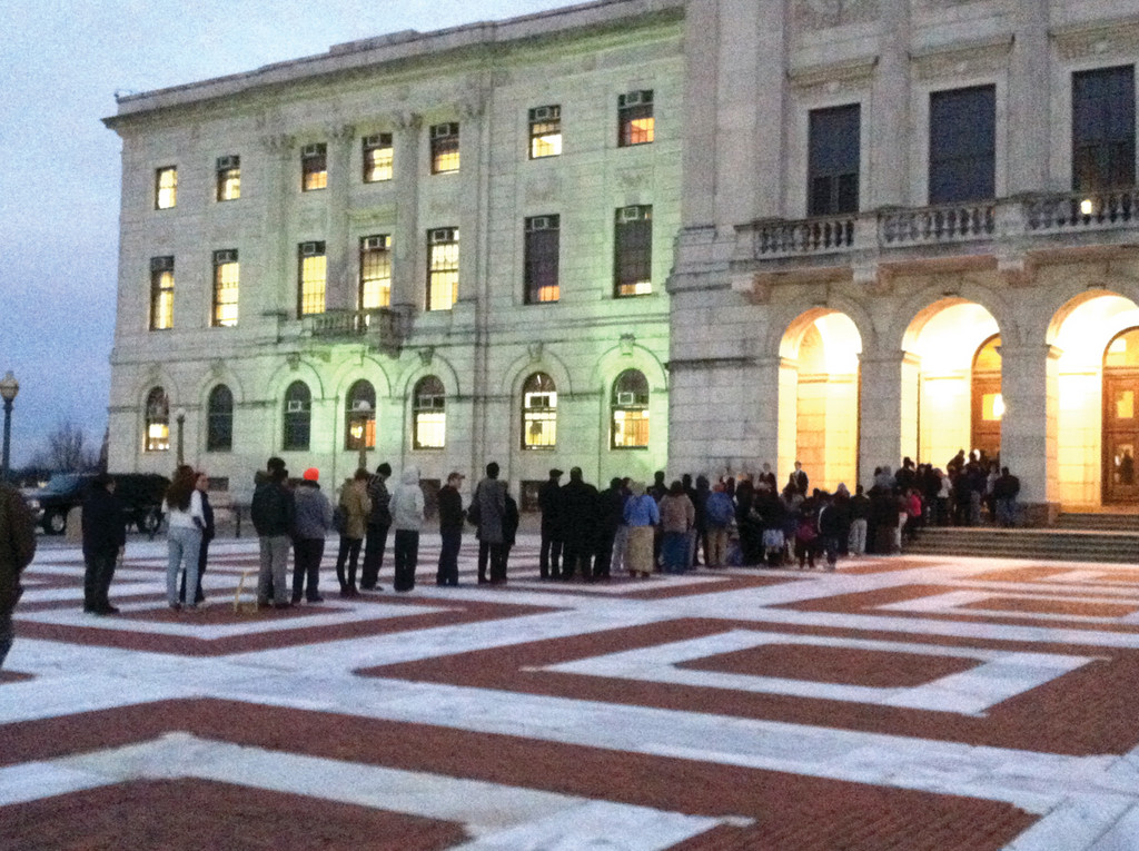 WAITING: The line outside of the State House Tuesday night at around 5, as advocates and opponents of same sex marriage waited to pass through metal detectors and into the building.