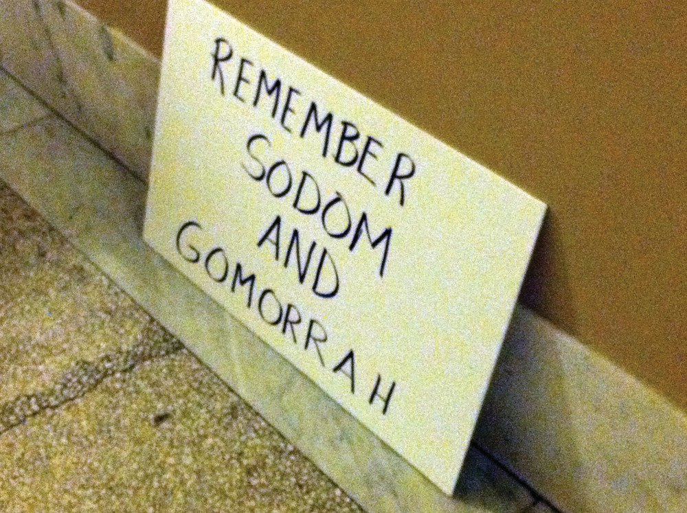 REMEMBER: A sign left by a same sex marriage opponent in the hall outside House Committee on Judiciary hearing room 313.