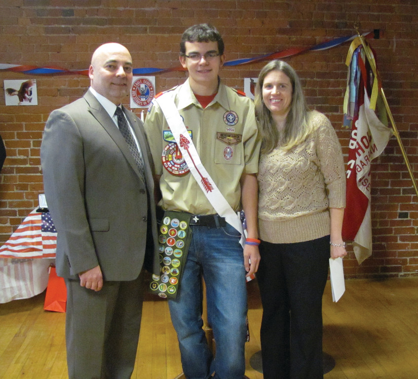 Sergio DeSousa-Rosa, Jr., one of three young men to achieve the rank of Eagle Scout, is joined by parents Sergio DeSousa-Rosa and Stacey DeSousa-Rosa at Sunday's ceremony held at the Providence Fire Fighters Hall.