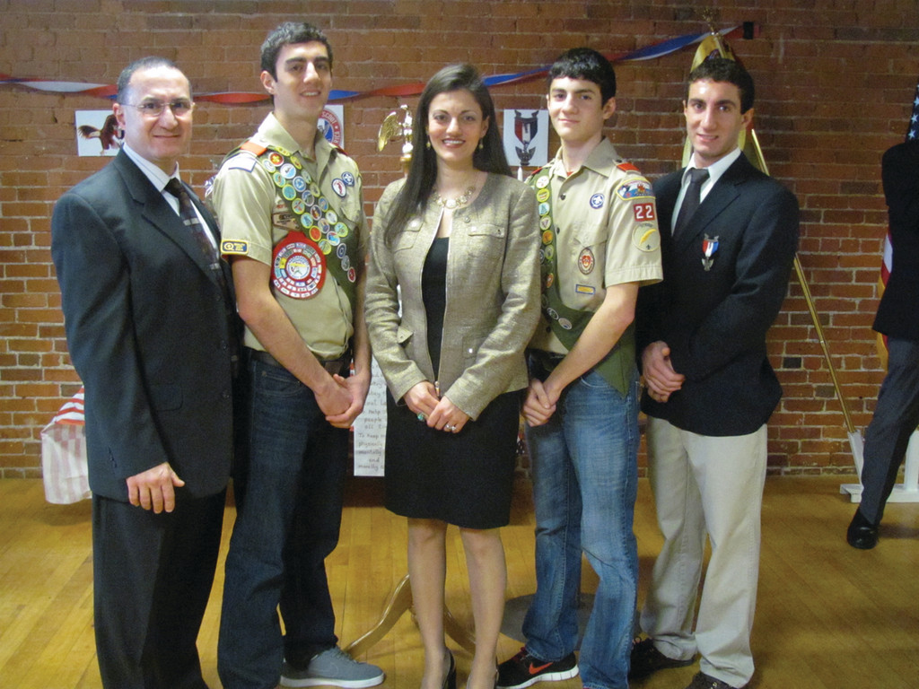 The Saggal family now has three Eagle Scouts, as John-Paul Saggal (second left) and Stephan Saggal (fourth left) received the distinction Sunday. They're joined by Assistant Scout Master Aboud Saggal, mother Mira Saggal and brother George Saggal, also an Eagle Scout.