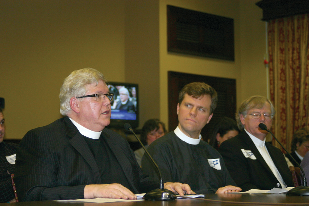 PRO-EQUALITY: From left, Reverends Eugene Dyszlewki, John Huyck and Don Anderson sit at the witness table before the House Committee on Judiciary Tuesday night. All three testified in favor of the marriage equality bill.
