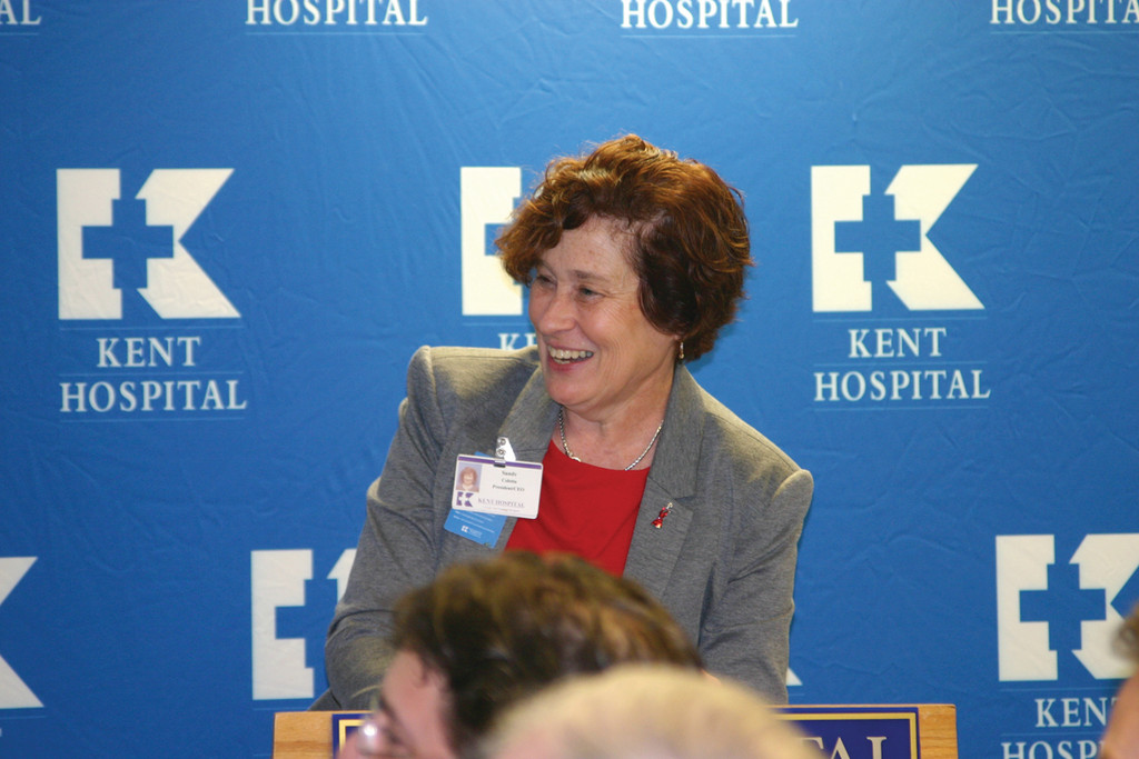 BIG ANNOUNCEMENT: Sandra Coletta, president and CEO of Kent Hospital, smiles as she recognizes Kent�s new cardiology specialists from Brigham & Women�s Hospital in Boston. The doctors will offer services at Kent as part of the new clinical affiliation between the hospitals.