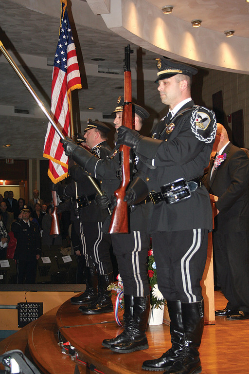 The Johnston Police Color Guard presents the colors at the start of the ceremony Monday night.
