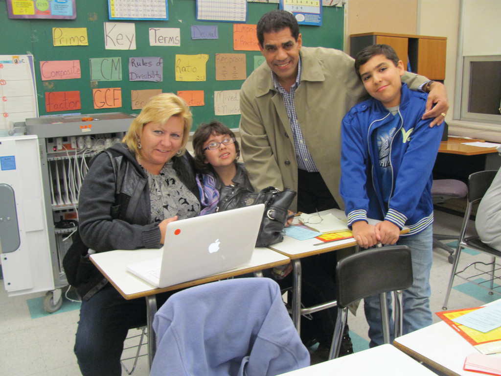 Kerry Westerman (left) joins Julie Rodriguez, Katie Rodriquez and Alexander Rodriguez at one of the five stations featured in Ferri Middle School's Family Math Night.