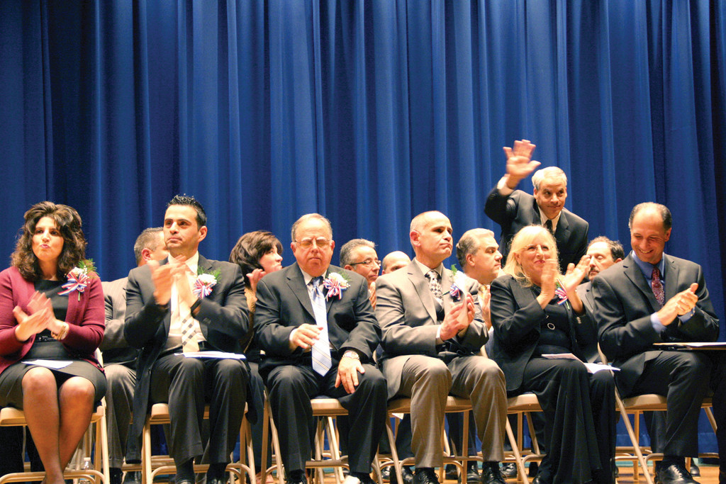 Rep. Gregory Costantino waves to the audience during introductions at the inaugural ceremony.