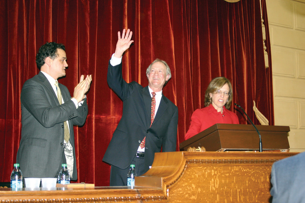 AT STATE OF THE STATE: Governor Lincoln Chafee waves after delivering his  address to legislators Wednesday. He is flanked by House Speaker Gordon Fox and Senate President Teresa Paiva-Weed.