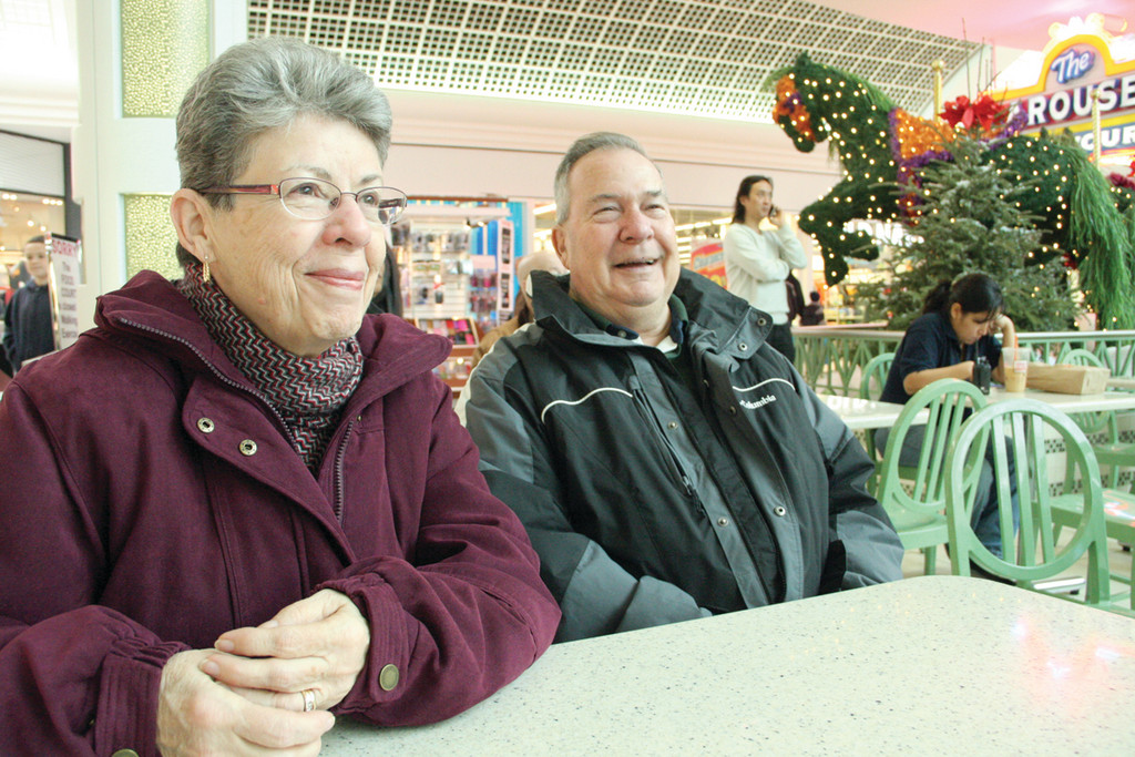 LET'S MAKE IT WORK: was the message of Joseph Sylvestre, who watched inauguration ceremonies with his wife Cynthia at the Warwick Mall Food Court.
