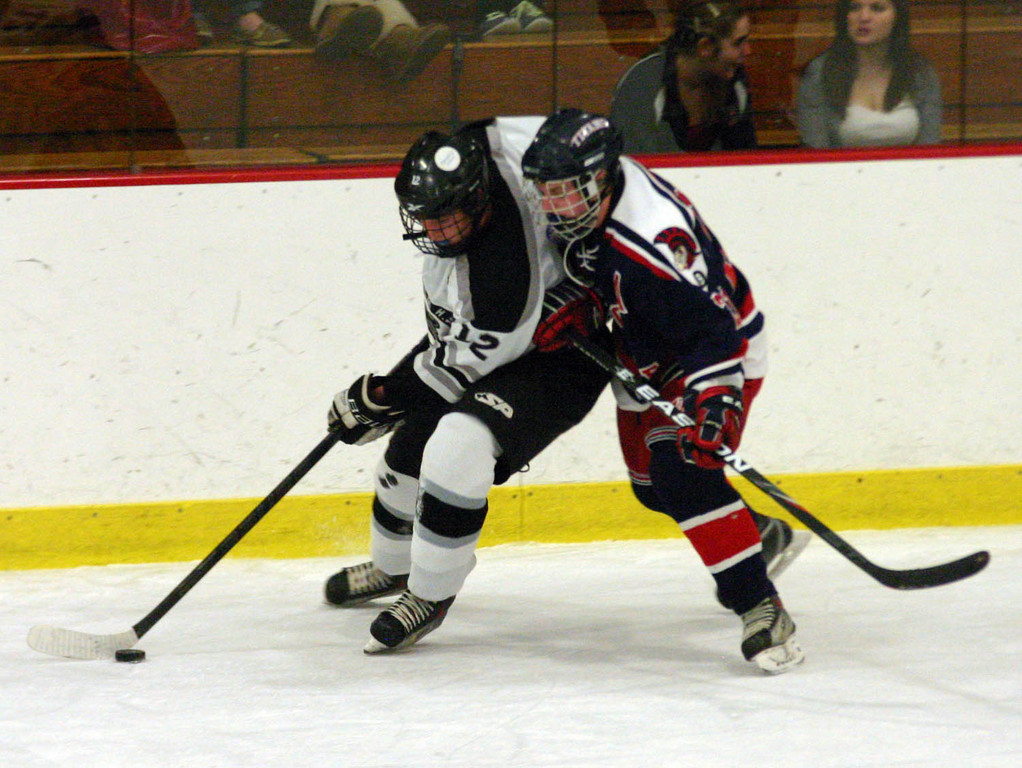 ONE ON ONE: Pilgrim's Sam Adamo (left) tries to get around Toll Gate's Mike Palumbo in Sunday's game.