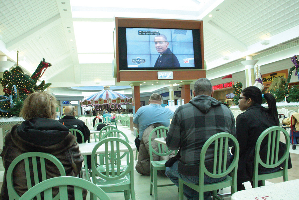 PLENTY OF SEATS: There was no shortage of seats for those wanting to see President Obama take the oath of office from the large screen at Warwick Mall.