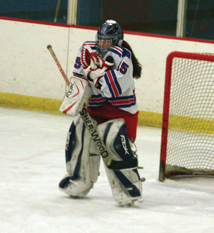 HOLD ON TIGHT: Warwick goalie Arielle Frank clutches the puck after stopping a high shot on Sunday.