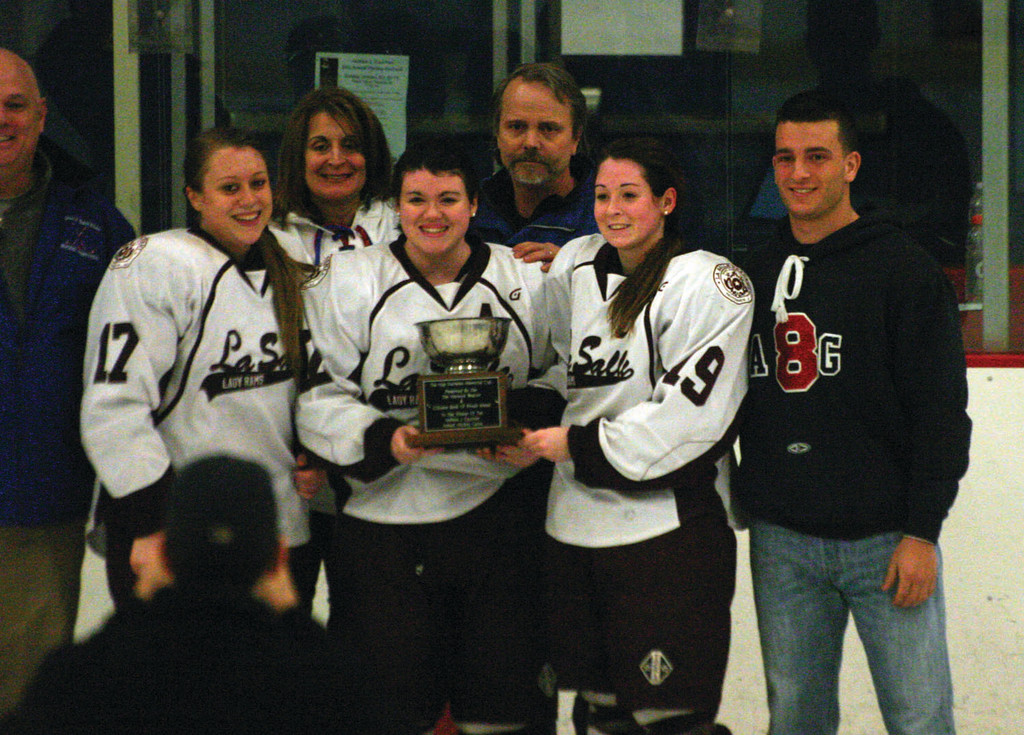 La Salle's captains pose with the Gauthier family after receiving the Hap Mathews trophy.
